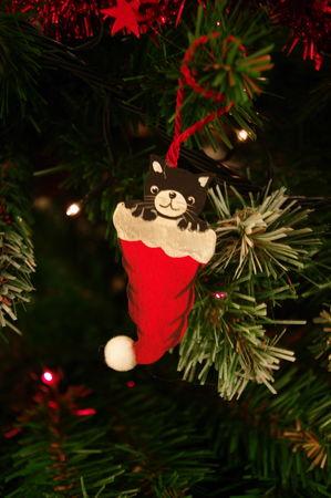 Petit chat de Noël en bois